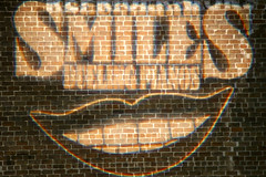 Smiling (fillzees) Tags: wall projected projection smile teeth words text typography image brick night sign