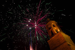 Under the fire. (Batide Machado) Tags: fuegosartificiales fire sky night bright stars church iglesia valladolid zamora cyl castillayleón ngc spain españa tradition mayorga fireworks art long exposition exposure longexposition longexposure largaexposición iso nikon d5100 pink yellow blue