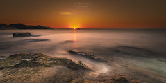 Empezar (sampler1977) Tags: horizonoverwatter sunrise villajoyosa amanecer leverdusoleil seascape longexposure pauselongue orange landscape rocks ciel sky marinabaixa marina