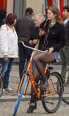 waiting (Henk Overbeeke Atelier54) Tags: girl street candid bike bicycle bicicletta fiets fahrrad vélo longhair swap nylons miniskirt jeans phone earphone