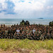 U.S., & Malaysian members gather for a group photo after storming a beach during Tiger Strike 2019