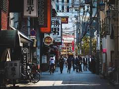 A Day in Japan (shiruichua) Tags: japan osaka street everyday life photography moody tones people buildings stores shops restaurants signs canont5i 50mm lens f18 stm 700d