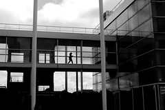 Into the air (pascalcolin1) Tags: paris13 femme woman passerelle footbridge verre glass fenetres windows ciel sky lumière light photoderue streetview urbanarte noiretblanc blackandwhite photopascalcolin 50mm canon50mm canon
