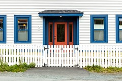 Trimmed in Blue (Karen_Chappell) Tags: white house red blue windows window door quidividi stjohns canada eastcoast atlanticcanada avalonpeninsula newfoundland fence paint painted wood wooden clapboard architecture building color colours colors colour colourful