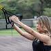 TRX girl exercising outside 2