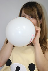 White May Be Pure (emotiroi auranaut) Tags: girl cute beautiful pretty fun white toy balloon growing big bigger blowingupaballoon glance glancing play playing playful air expanding blow squeak round tease teasing mischief mischievous grow sweet adorable