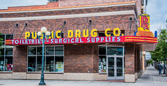 2019 - Road Trip - 112 - Great Falls - 2 - Public Drug Co. (Ted's photos - For Me & You) Tags: 2019 cropped greatfalls montana tedmcgrath tedsphotos usa vignetting publicdrugco publicdrugcogreatfalls greatfallspublicdrugco greatfallscentralavenue greatfallsmontana red redrule streetscene street streetlamp 1people