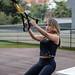 TRX girl exercising outside 3