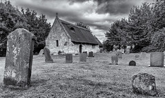 A rare building (David Feuerhelm) Tags: mono monochrome blackandwhite bw noiretblanc schwarzundweiss blancoynegro building church history historic old gravestones churchyard roof thatch sky clouds nikkor 2470mmf28 nikon d750 markby lincolnshire england