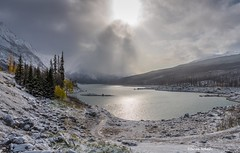 Stormy skies over Medicine Lake (Photosuze) Tags: trees pines canadianrockies jaspernationalpark lakes landscapes alberta nature clouds mist sun snow ice