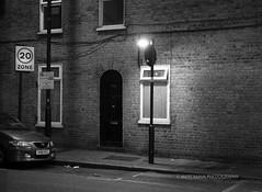 Night Post (Mars Mann) Tags: blackandwhitephotography urbanphotography lowlight lamp car door evening marsmannphotography light building flickrmarsmann