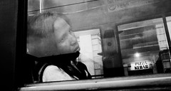 Another day. (Baz 120) Tags: candid candidstreet candidportrait city contrast street streetphoto streetcandid streetportrait strangers rome roma ricohgrii europe women monochrome monotone mono noiretblanc bw blackandwhite urban life portrait people provoke italy italia girl grittystreetphotography faces decisivemoment