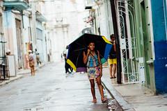 Girl Under Umbrella, Havana Cuba (AdamCohn) Tags: adam cohn cuba havana girl rain streetphotographer streetphotography umbrella wwwadamcohncom adamcohn