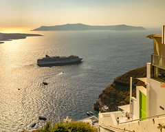 Sunset on the Luxury Life (armct) Tags: thira southaegean greece fira santorini cyclades sunset calm sea island cuboid luxury liner ship tender passenger horizon skyline buildings