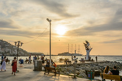waiting for sunset (stevefge) Tags: 2019 kusadasi turkey sunset sundown landscape sea sculpture boats ships jetty masts street people candid unsuspectingprotagonists unsuspecting nikon reflectyourworld reflections sky