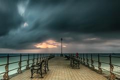 Sunrise calamities (Christine down south) Tags: swanage banjopier moody longexposure rain clouds stormy pier groyne