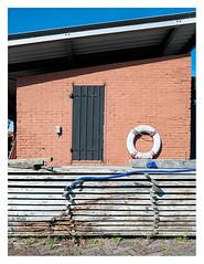 At the shipyard _ 2 (leo.roos) Tags: zon muur oranj solaag lichtsch darosa leoroos a7rii laowa154 venusopticslaowa15mmf4widemacro wall lifebuoy reddingsboei wood zeeland shipyard walcheren scheepswerf arnemuiden historischewerfmeerman werfcameerman