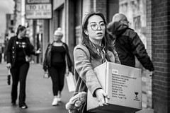 Fragile (Leanne Boulton) Tags: urban street candid portrait portraiture streetphotography candidstreetphotography candidportrait streetportrait eyecontact candideyecontact streetlife woman female girl face eyes expression emotion mood feeling glasses hands carrying box dinnerservice shopping tone texture detail depthoffield bokeh naturallight outdoor light shade city scene human life living humanity society culture lifestyle people canon canon5dmkiii 70mm ef2470mmf28liiusm black white blackwhite bw mono blackandwhite monochrome glasgow scotland uk