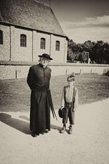 029 (boeddhaken) Tags: backintime timetravel 1900 1900s blackwhite bw retro retrostyle museum priest boy youngboy church