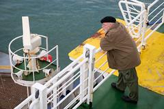 Railing man (paul indigo) Tags: paulindigo beret colour composition environment fashion ferry harbour horizontal man people port portrait style travel