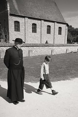 028 (boeddhaken) Tags: backintime timetravel 1900 1900s blackwhite bw retro retrostyle museum priest boy youngboy church