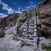 Wooden ladder on trail leading to the mesa top at the ancestral Pueblo village of Tsankawi along the Tsankawi Ruins Trail in Bandelier National Monument, New Mexico