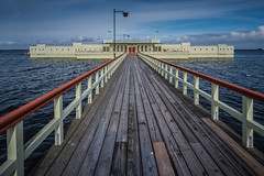Ribersborgs Kallbadhus (Dannis van der Heiden) Tags: ribersborgs kallbadhus öresund malmö sky clouds water bird wood railing sweden restaurant bathhouse streetlight jetty pier nikond750 d750 tokina1628mmf28