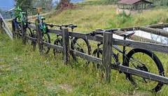 Bicycles on a Fence (magnetic_red) Tags: bicycle fence pasture rural scenic rustic colombia