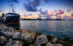 Miami sunset in Florida (` Toshio ') Tags: toshio miami florida ship jetty rocks harbor biscaynebay bay sunset clouds boat water fujixt2 xt2 baysidemarketplace bridge