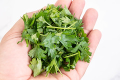 Chopped Parsley in the hand above white background (wuestenigel) Tags: spice eating bunch herb garnish closeup cut cooking leaf fresh vegetable nature background healthy parsley aromatic raw plant vegetarian herbal pieces seasoning ingredient food freshness health green isolated preparation kitchen white petersilie würzen essen kochen aromatisch blatt ingredients zutaten gemüse kraut garnierung gesundheit culinary kulinarisch gesund isolate isolieren cluster cilantro koriander condiment würze perfume parfüm taste geschmack relish geniesen 2019 2020 2021 2022 2023 2024 2025 2026 2027