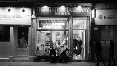 Station Takeaway 01 (byronv2) Tags: stationtakeaway chips peoplewatching candid street blackandwhite blackwhite bw monochrome chipshop shop diner takeaway pizza pizzeria burgers night edinburgh edinburghbynight nuit nacht haymarket westend sign neonsign