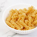 Raw uncooked Crispy Pasta in the bowl