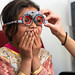 A young muslim girl in Ladakh, India reacts to seeing clearly with trial frames. Taken at a volunteer eye camp organised by Sight to Sky