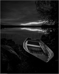 The Wilful Boat (niggyl (getting there)) Tags: suomi finland centralfinland jyväskylä myhinpääntie lakevhvanen nikcollection dxolabs blackandwhite bw monochrome monochromatic bnw bnwseascape lowkeyblackandwhite silverefexpro silverefexpro2 breathtakinglandscapes landscape lake reeds sundown clouds reflection water ripples fujifilm fujifilmxt1 fujixt1 xt1 samyang samyang12mmf2 samyang12mm rokinon rokinon12mmf20ncscs samyang12mmf20ncscs samyangcsc12mmf20ncscs longexposure theethereallongexposure leefilters longexposurephotography contrejour boat rowboat