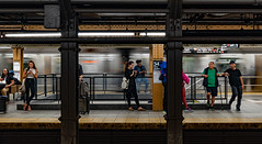 Connected at Penn... (Aleem Yousaf) Tags: travel nikon d850 nikkor big apple nyc new york usa united states america city cityscape photography walk building downtown lights shadows september 2019 wide angle 1835mm subway mid manhattan people frame pillars station pennsylvania 34th street engrosed pose daily lives busy digital camera world flickr commuters diverse cosmopolitan