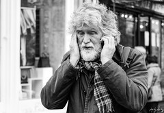 I Can't Hear You! (Cycling-Road-Hog) Tags: beard candid canoneos750d citylife edinburgh edinburghstreetphotography hairstyle phone places royalmile scarf scotland street streetphotography streetportrait style urban