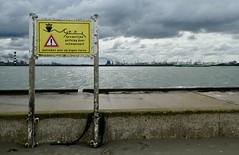 At own risk (sander_sloots) Tags: port rotterdam risk eigen risico dam pier nieuwe waterweg hoek van holland sign dctz90 panasonic lumix bord clouds wolken scheepvaart industrial landscape maasvlakte