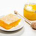 Bee products with honey and sweet honeycomb on white background, healthy products, organic natural ingredients concept