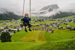 Magic Carpet Ride (freundsport) Tags: family landscape nature swing clouds mountains austria sky meadow tree