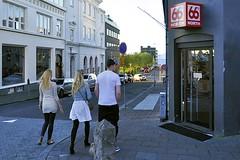 Leaving Laugavegur (AntyDiluvian) Tags: iceland reykjavik laugavegur street shoppingstreet shops restaurant girls guy 66°north