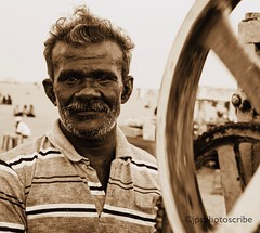 Crushed fruit (stewardsonjp1) Tags: face interesting streetportrait streetphotography portrait monochrome crush machine man drink fruit hot evening beach india chennai