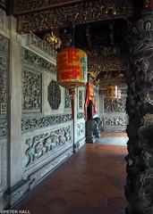 Lantern (peterphotographic) Tags: p7240431edwm lantern olympus em5mk2 microfourthirds mft ©peterhall khookongsi penang malaysia seasia asia temple chinese red corridor carving building architecture unesco