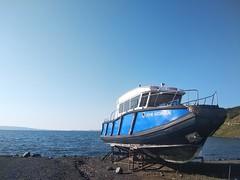 Boat on lakeside (Alexanyan) Tags: çıldır lake հիւսիսեան ჩრდილი чилдыр tsiltiri ardahan province turkey ծովակ լիճ boat coast guard ჩრდილის ტბა blue water