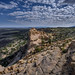Sandstone cliff and volcanic plain at El Malpais National Monument near Grants, New Mexico