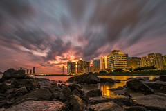 Looking Up at Macau (Geraint Rowland Photography) Tags: mgm mgmmacau macao macau visitmacau vhinamacao wowmacao casinos building waterfront lights sunset sun settingsun takenwithacanon5d4andacanonef1635mmf28liiusmat16mmfor30secondsofexposure wwwgeraintrowlandcouk clouds water reflection nature asia visitasia travelimages wanderlust geraintrowlandphotographyblog wanderlusttravelmagazine weather tourism landscapephotography lowlevel wideangle lookingup getty