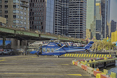 Flying Machine at Heliport at 34th Street, NYC, Heliport (nrhodesphotos(the_eye_of_the_moment)) Tags: dsc77183001084 flyingmachines heliport nyc manhattan metal outdoors architecture reflections shadows helicopter highway colorsofnyc transportation roadway eastriver waterfront autos parkinglot gate barriers windows glass skyscrapers buildings signs