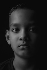 DSCF1915-6 (YouOnFoto) Tags: boy jongen black white zwart wit closeup dichtbij natuurlijk licht natural light shadow schaduw portret portrait kids kinderen fujifilm face gezich eyes ogen