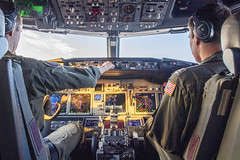 Lt. Levi Ellis, left and Lt. Bradley Woods pilot a P-8A Poseidon assigned to Patrol Squadron (VP) 47 as part of a sinking exercise (SINKEX).