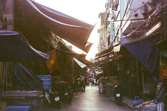 Hanoi Street (hiphopmilk) Tags: film analog analogue 35mm 135film kodakfilm kodak jaredyeh hiphopmilk nikonfm2 nikonfm2n nikon nikkor vietnam hanoi travel streetphotography street copyright©jaredyehwooehmoehfilms city scooter motorbike
