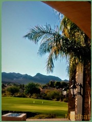 A Wonderful View from LLV Sports Club (medaibl) Tags: golf llvsportsclub pato lakelasvegas henderson nevada architecture queenpalmtrees bluesky sumnshine mountains hills pond water fireplace colors green accentlighting gasfireplace accentbluebeeds